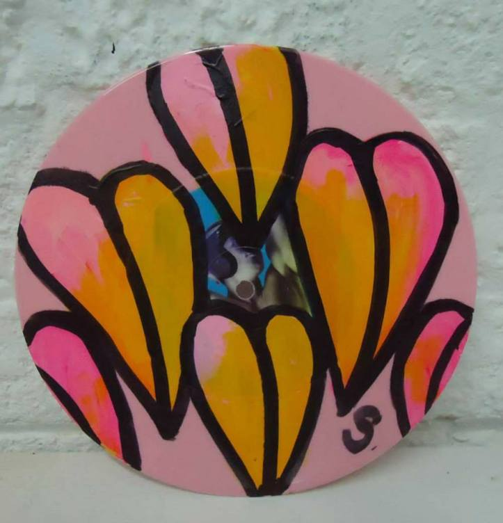 """Jan 18th 2014 - New layers...  Acrylic, spray paint, marker pen on a found (in the street) 7"""" pink vinyl record"""