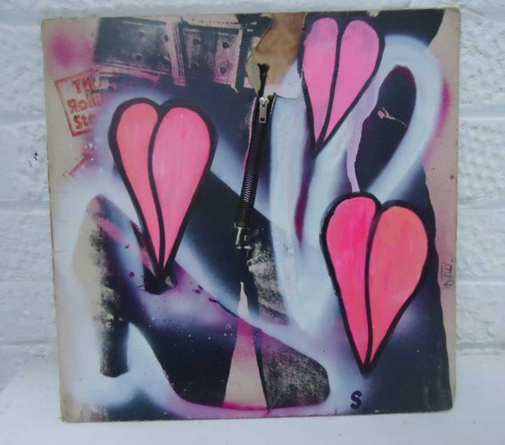 JAN 25th 2014 - Fresh leaf growth and an old (red) Italian shoe on an sticky fingered Andy Warhol Rolling Stones cover....